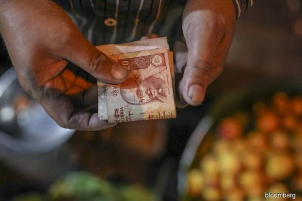 Rupee surges most in 18 months as India plans steps to end rout