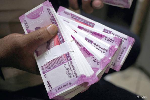 Bearish bets on Indian rupee, Indonesian rupiah at highest in years