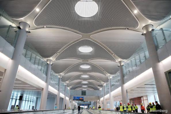 Financial strain seen at world's biggest airport before it opens
