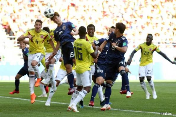 Soccer: Japan sink 10-man Colombia in historic win for Asia