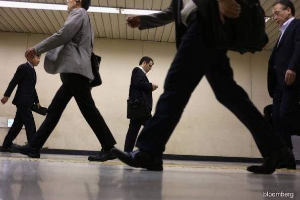 Pay for Japanese Workers Makes Biggest Monthly Jump Since 1997