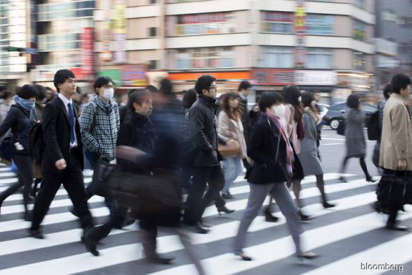 Pay for Japanese workers jumps as bonuses pick up
