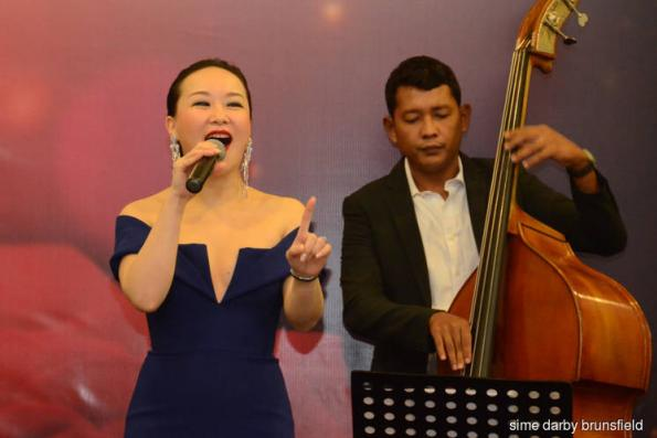 Sime Darby Brunsfield's guests entertained by singer from Crazy Rich Asians