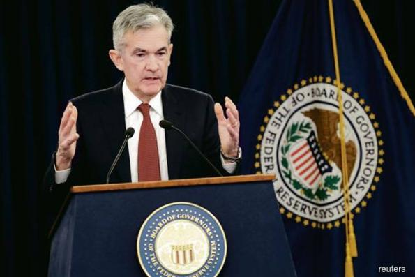 Fed weighs growth against market fragility