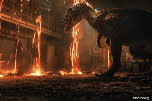 Jurassic World roars past US$100 mil in debut weekend