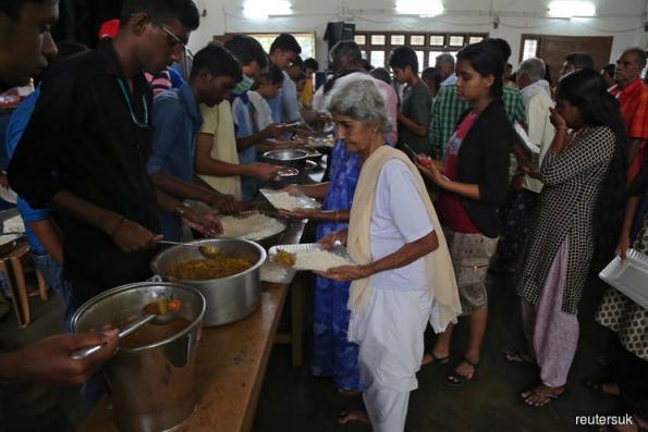 Death toll nears 400 in India's flood-hit Kerala, dozens missing