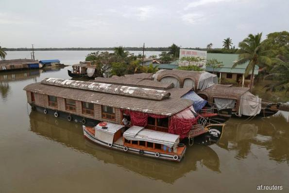 After flood, tourism in India's Kerala left mud-bound