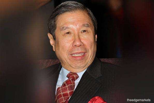 Tycoon Khoo Kay Peng makes way for son