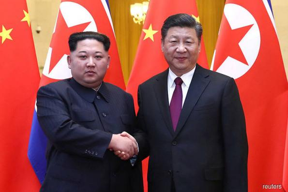 As Kim visits China, Xi flaunts bargaining chip in trade dispute