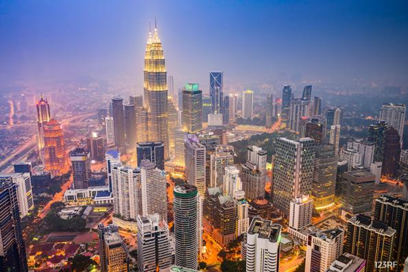 Singapore-Malaysia bond spread has one trillion reasons to widen