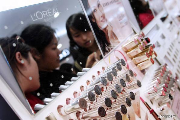L'Oreal rises above China slowdown as luxury cosmetics surge