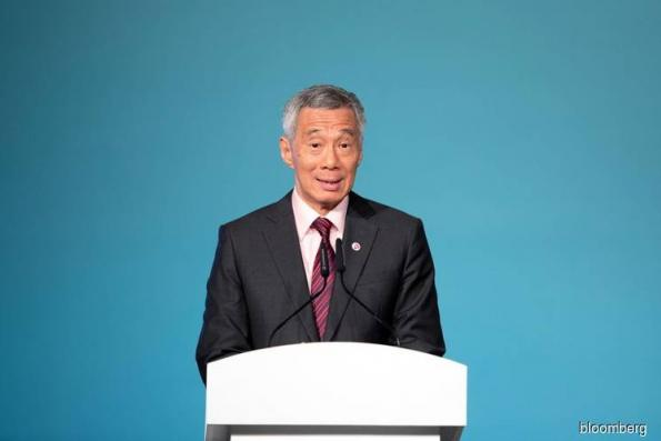 Singapore PM files defamation suit against blogger who shared article on Facebook