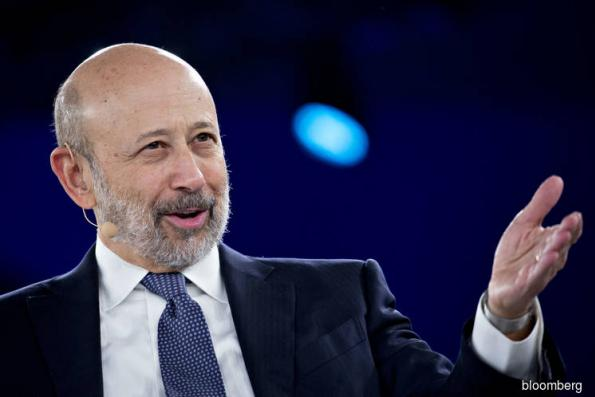 Goldman's Blankfein met with financier at core of 1MDB probe