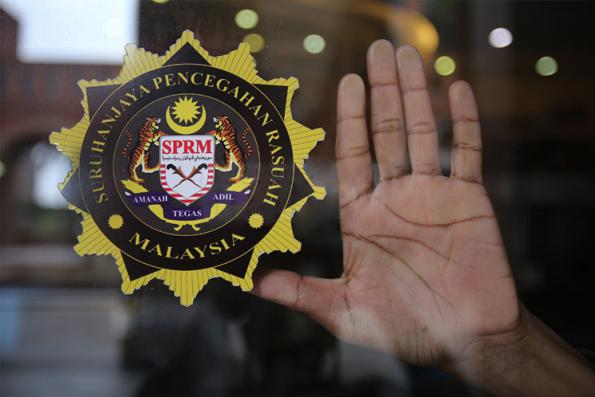 Company director with 'Datuk' title among three held for corruption