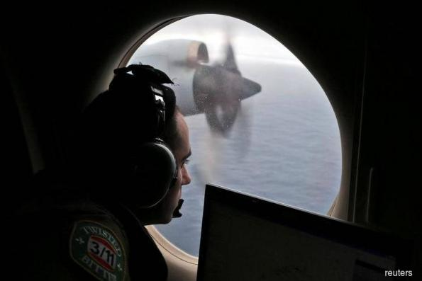 Malaysia says private search for MH370 to end next week