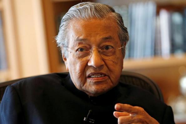 Mahathir revives Singapore water dispute, takes swipe at Trump