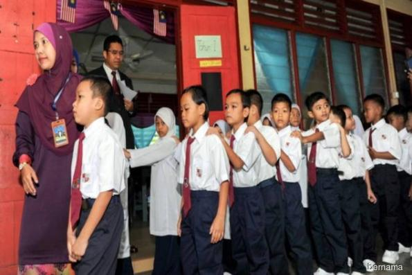 Malaysia to revise school textbook telling girls to cover up