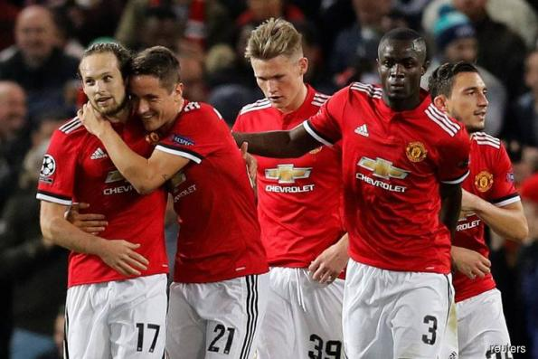 United close to knockout stage with 2-0 win over Benfica