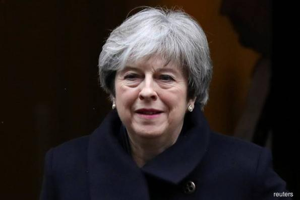 UK PM May seeks business support for EU deal as she faces day of reckoning
