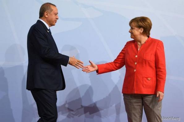 With stakes rising, Merkel enters the fray to calm Turkey turmoil