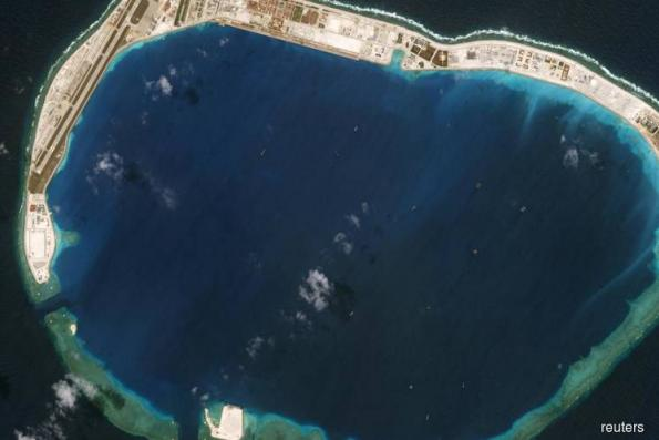 Concrete and coral: Beijing's South China Sea building boom fuels concerns