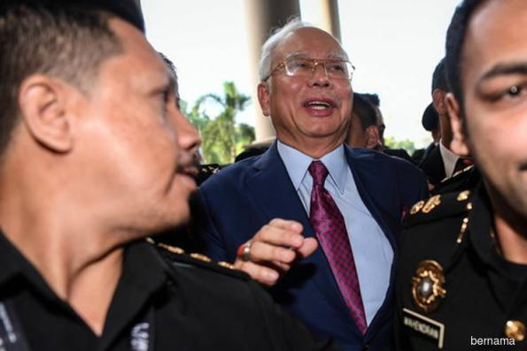 Court grants Najib bail of RM3.5m after he claims trial to 25 charges