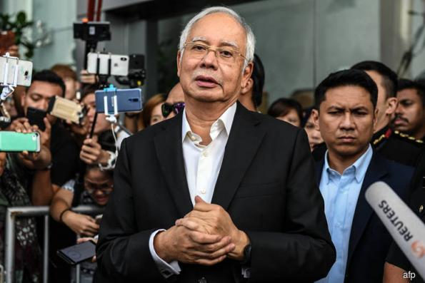 Najib Faces Jail Time, Whipping After Being Charged in 1MDB Case