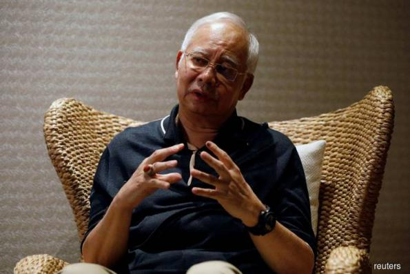 Najib to face 21 money laundering charges - police