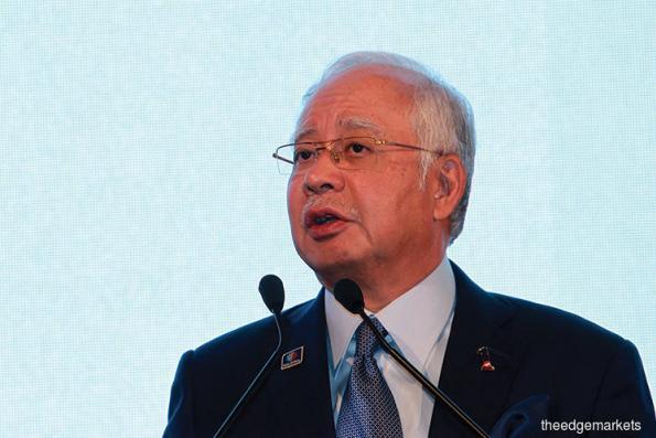 Ahead of polls, Najib steps out of Mahathir's long shadow