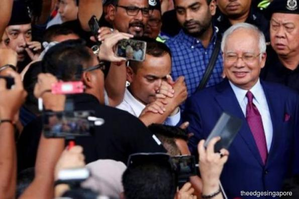 Najib finally nabbed, but what does this mean for Singapore?