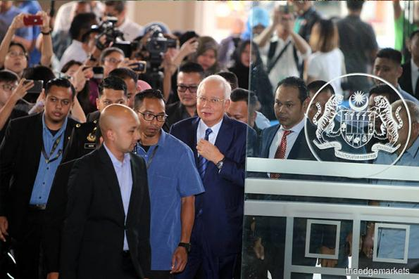 Najib leaves court complex, declines to speak to reporters
