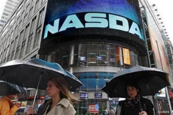 Tech gains lift Nasdaq; consumer stocks weigh on S&P, Dow