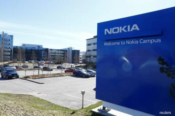 Nokia posts sharp quarterly profit fall, sees 5G accelerating