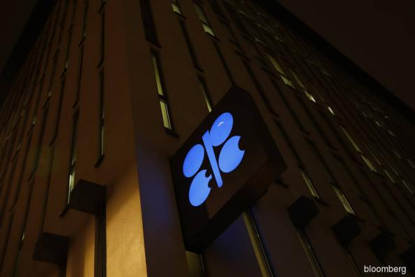 OPEC agrees on larger-than-expected oil cut after marathon talks