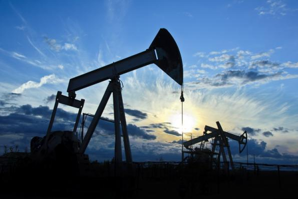 Oil slides on Wall Street slump and crude supply worry