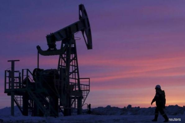 Oil edges up as US crude stocks fall, Iran sanctions weigh
