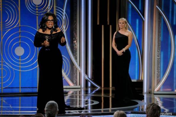 Oprah Winfrey claims lifetime Golden Globe, calls for 'a new day'