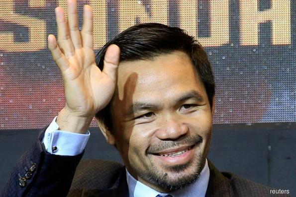 BOXING: Pacquiao not closing the door on trainer Roach