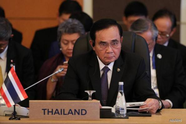 Thai PM sets Sept deadline to decide on role in politics ahead of election