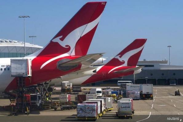 Australia's Qantas posts record annual profit, announces share buyback