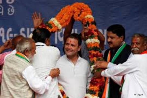 India's Rahul Gandhi takes helm of Congress party to challenge Modi