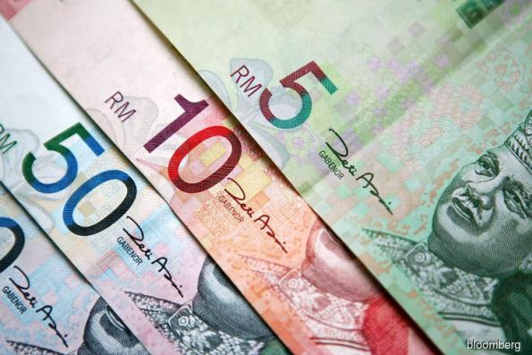 Ringgit edges lower after four weeks of gains