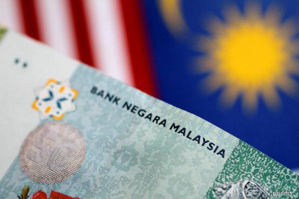 Ringgit drops to two-week low in catchup play