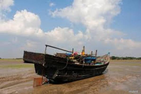 Myanmar holds 106 Rohingya aboard boat to Malaysia, official says