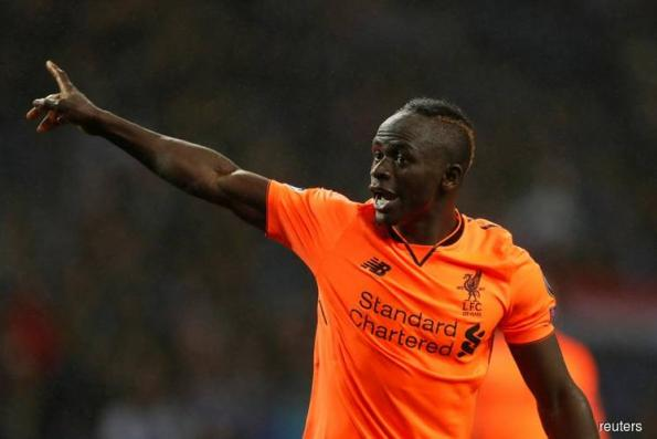 Mane bursts back into life with first Liverpool hat-trick