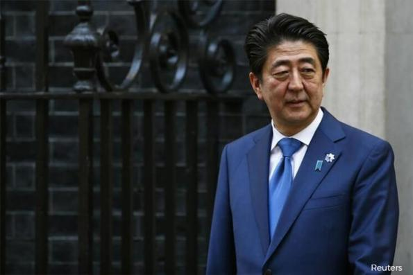 Japan ruling bloc heads for big election win despite voter distaste for PM Abe — poll