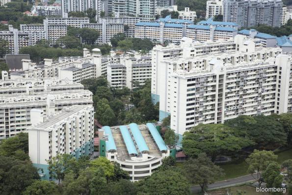 Singapore property developers fall after higher home purchase tax