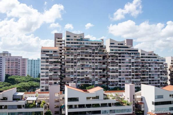 Singapore Property Stocks Fall on Higher Tax for Home Purchases