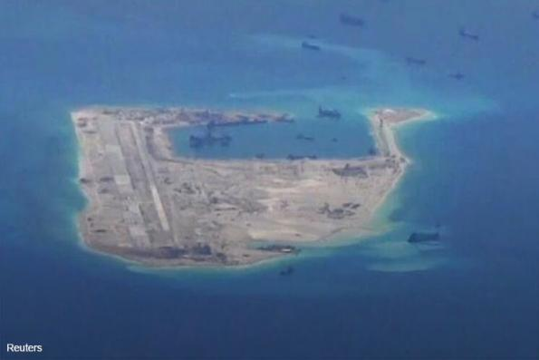U.S. warship drill meant to defy China's claim over artificial island — officials