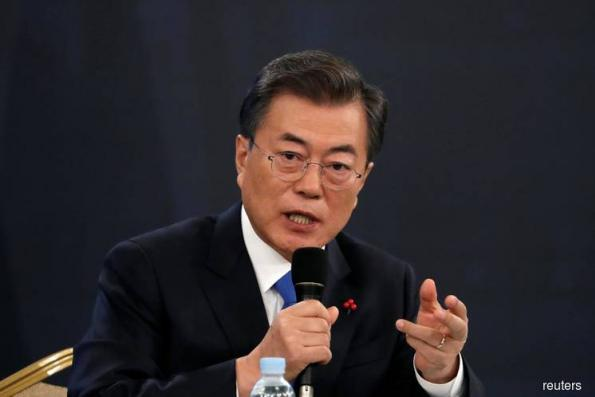 S.Korea's Moon bemoans GM plant closure move, calls on govt to help workers